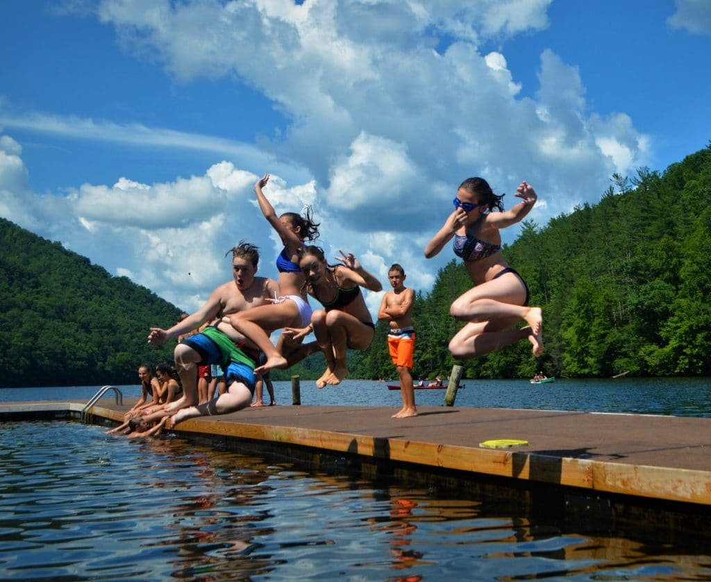 Camp Henry kids jumping in water